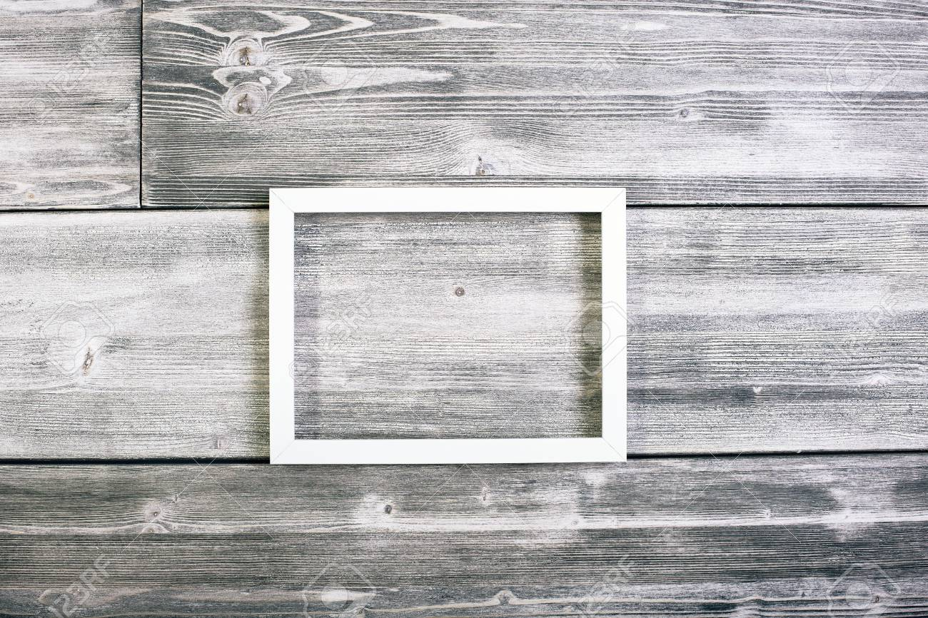 White See-through Frame Hanging On Antique Wooden Wall. Mock.. Stock ...