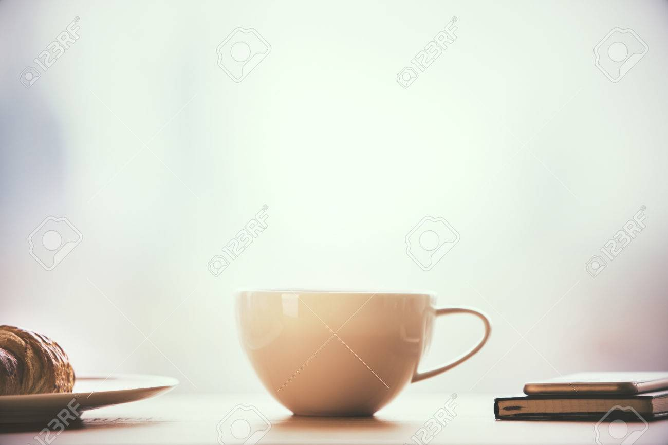 Closeup Of Round Coffee Mug On Table With Croissant Notepad Stock Photo Picture And Royalty Free Image Image 56034251