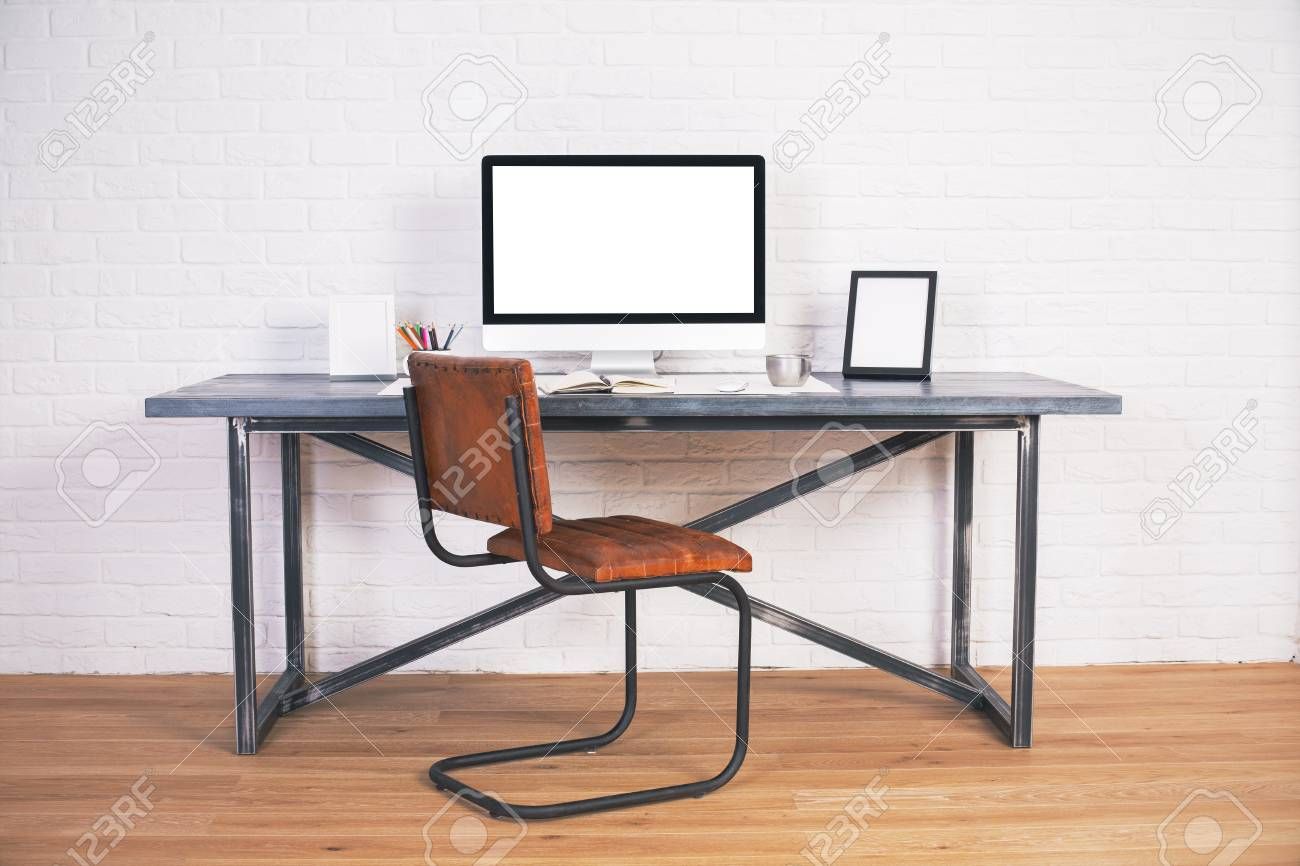 Front View Of Designer Desk With Blank Computer Screen, Frames ...