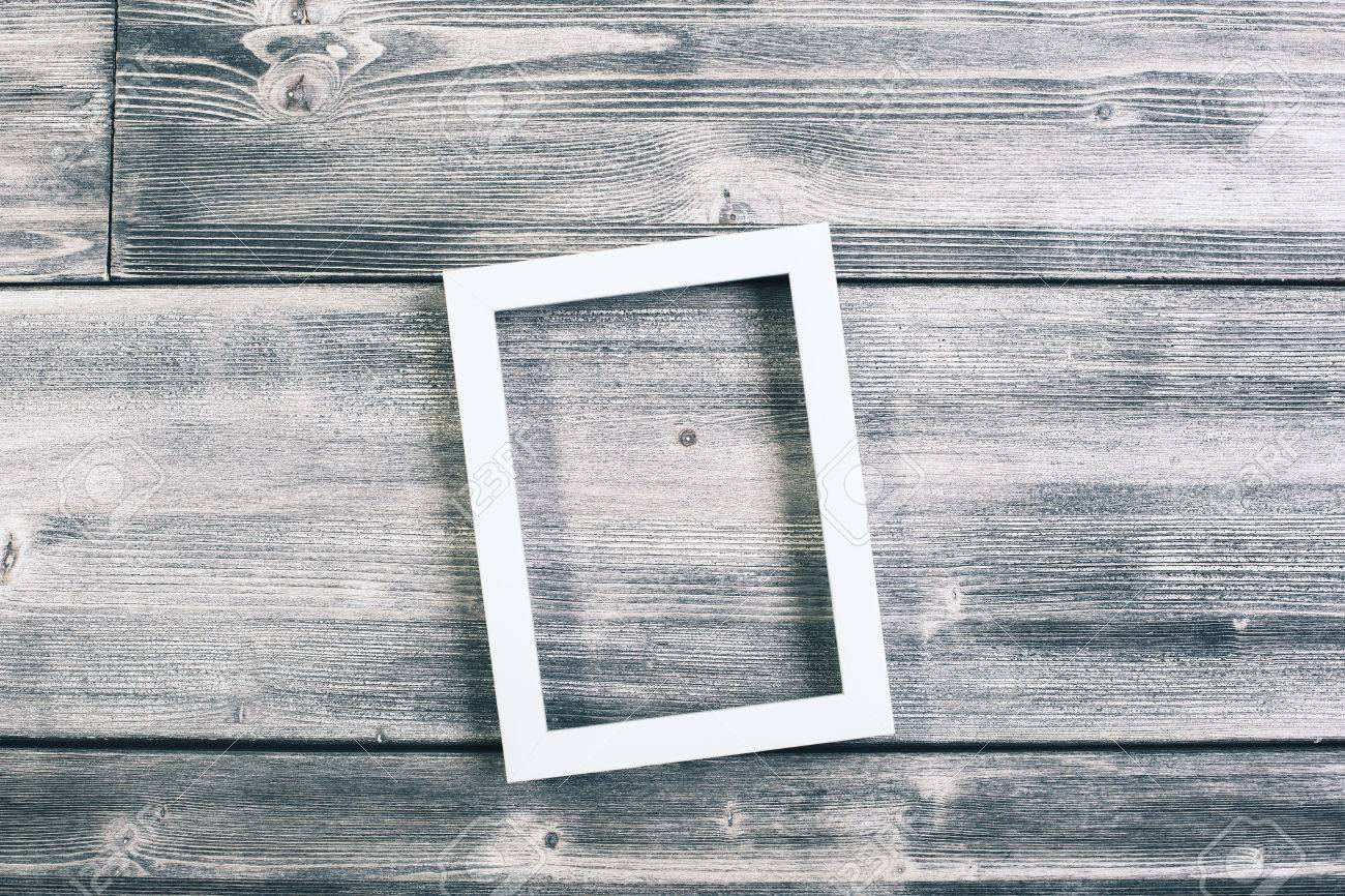 See Through Picture Frame Hanging On Wooden Wall. Mock Up Stock ...