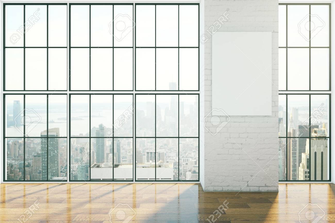foto de archivo entre el diseo vaco con ventanas con marcos suelos de madera y cartel en blanco en la pared de ladrillo maqueta d