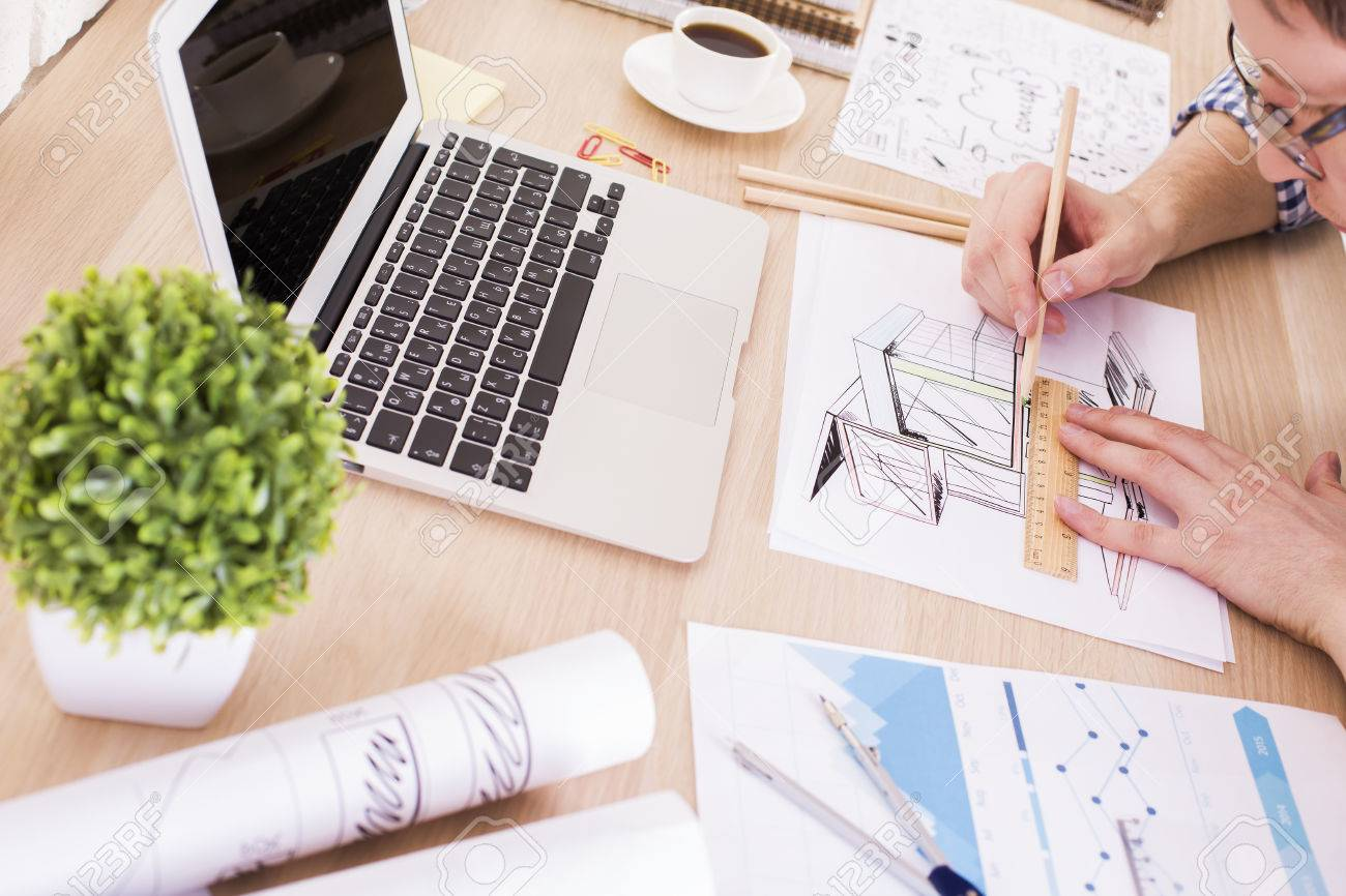 european cup office coffee. European Architect Using Ruler And Pencil To Draw Construction Sketch On Wooden Office Desktop With Blank Cup Coffee E