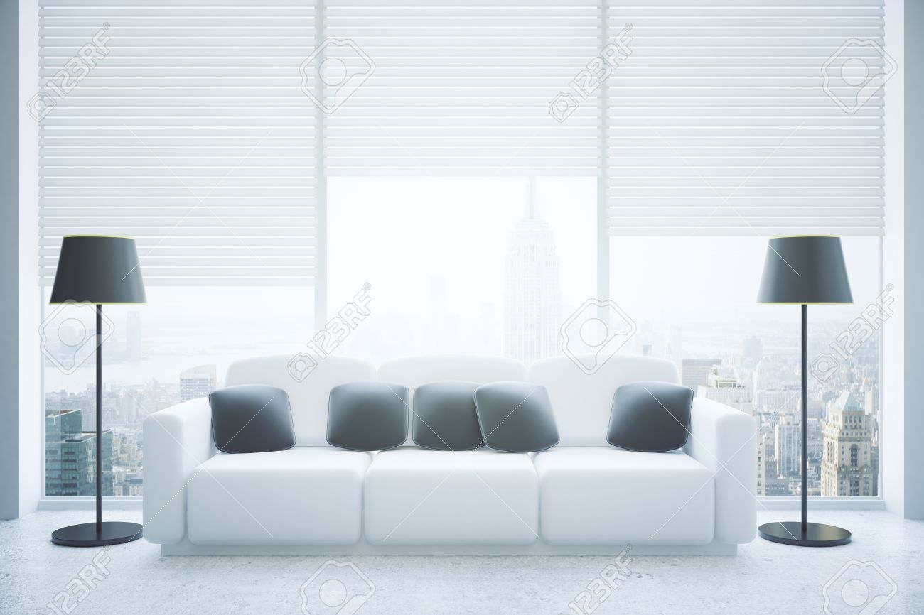 Front View Of Modern Living Room Interior With Black Pillows On White  Couch, Floor Lamps