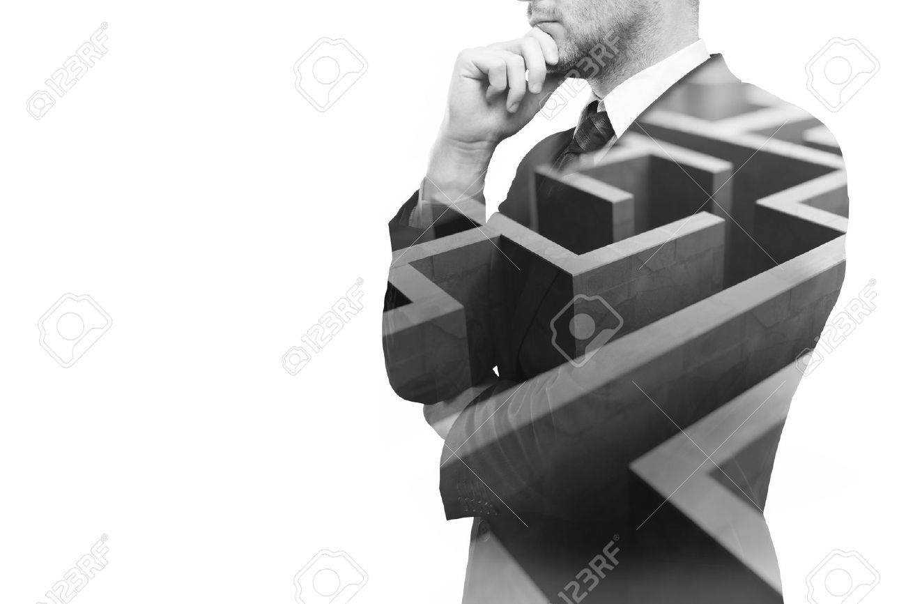 Young businessperson thinking about ways to overcome business obstacle. Isolated on white background with maze and copy space. Double exposure - 59959423