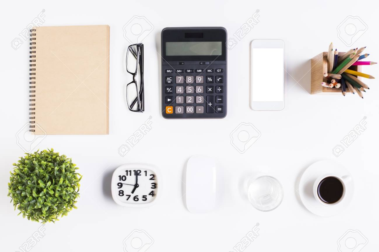 Top View Of Light Office Desktop With Blank Spiral Notepad Glasses