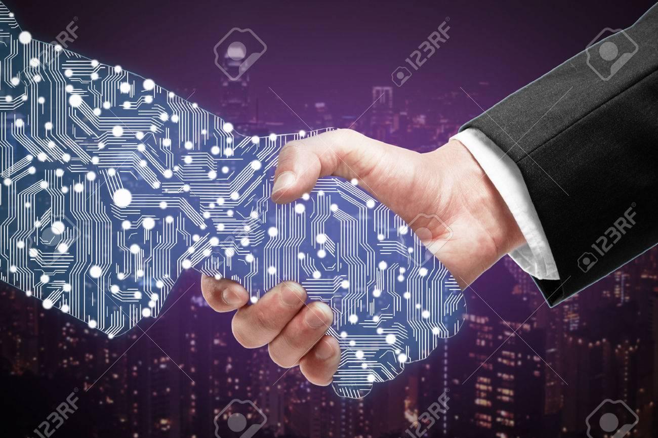 Businessman shaking digital partners hand on purple city background Standard-Bild - 61527324