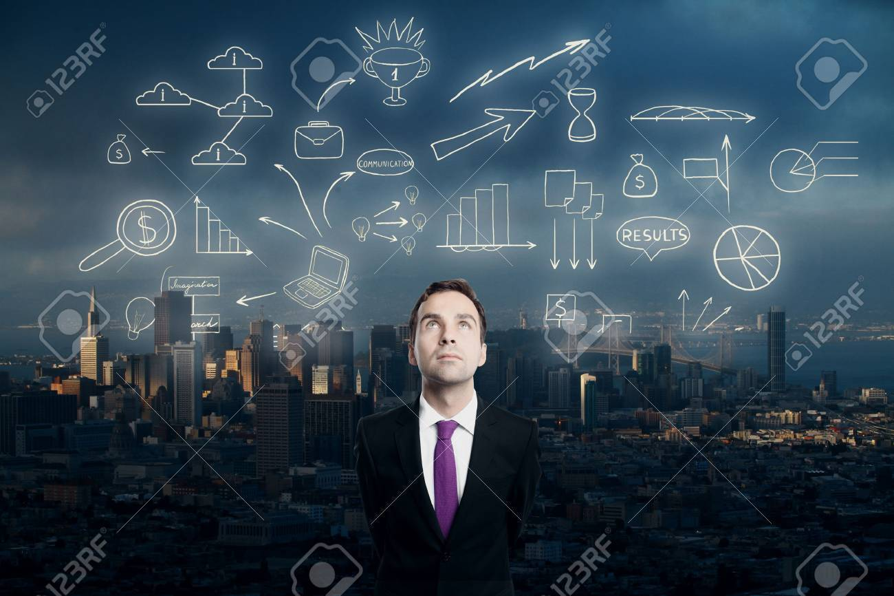 Businessman looking up at abstract business sketch on city background Standard-Bild - 61612710