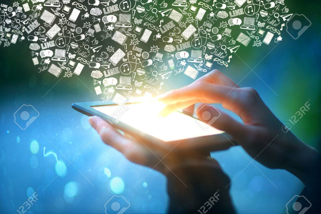 Closeup of male hands holding and touching illuminated screen of digital tablet with abstract communication icons on blue background. Social media concept Standard-Bild - 62005198