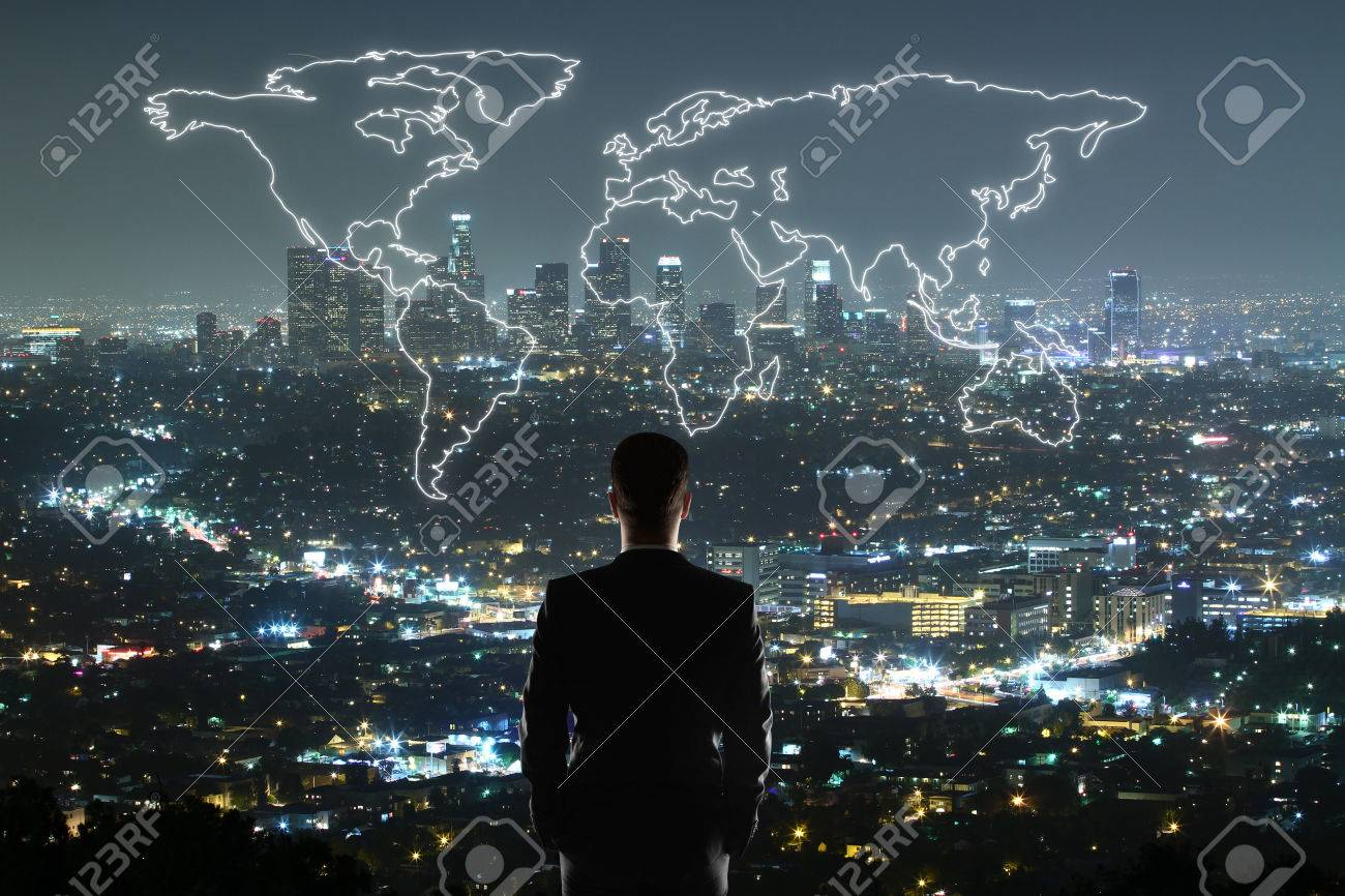 Travel concept with businessman looking at anstract map on illuminated night city background - 62004265