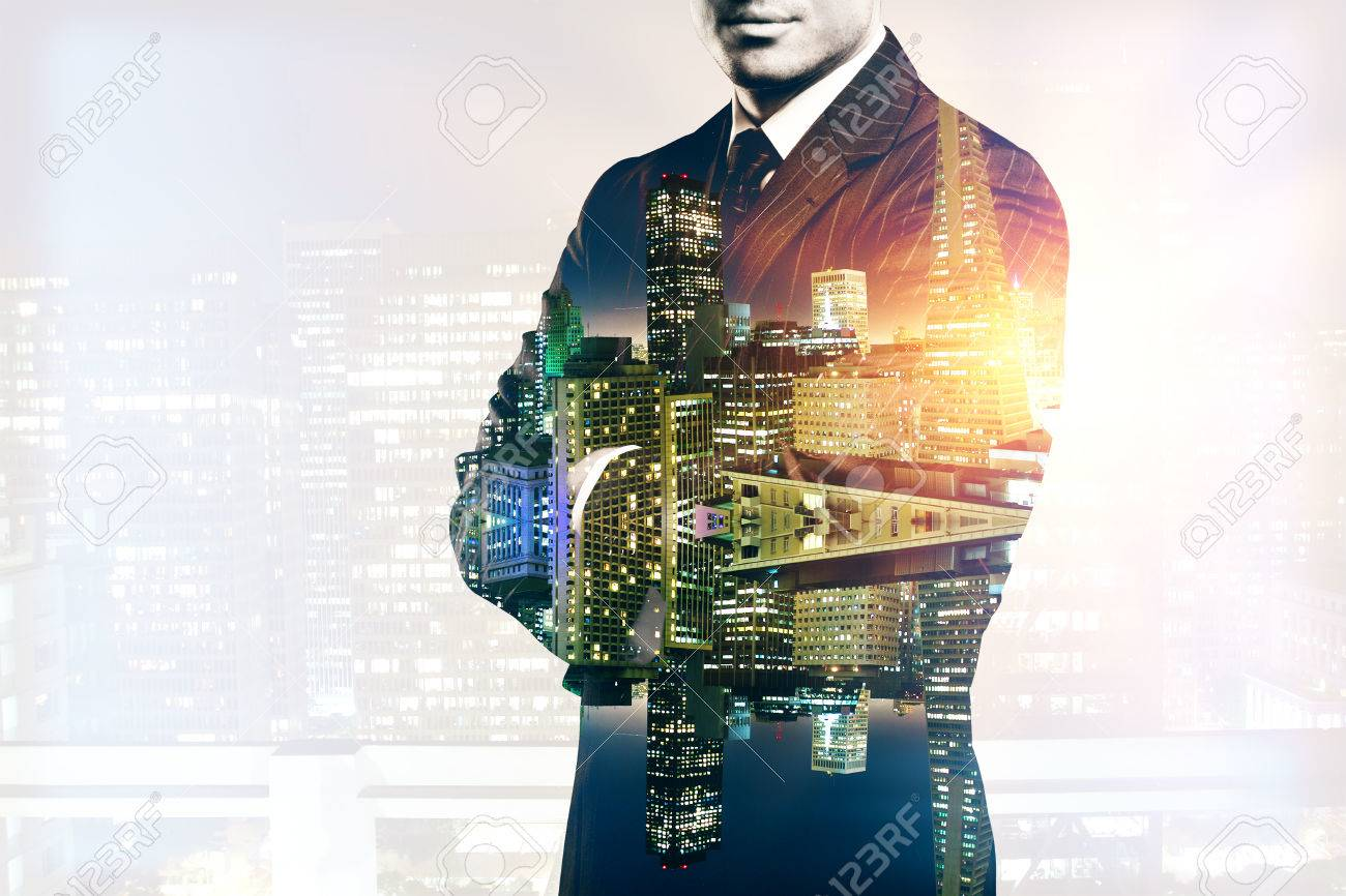 Young man in suit and with folded arms on abstract illuminated night city background. Double exposure - 63392099