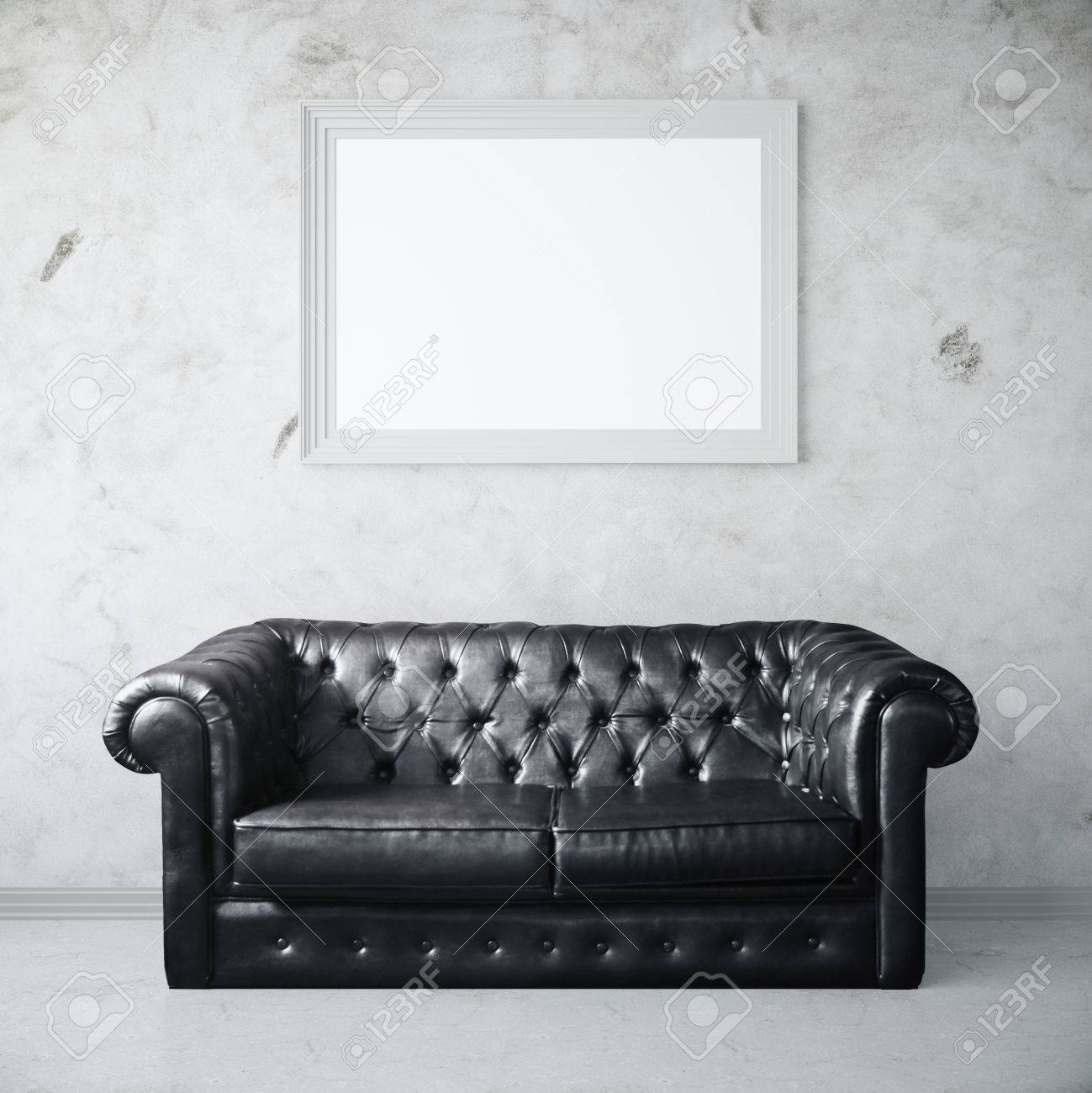 Concrete interior with dark leather sofa and blank photo frame...