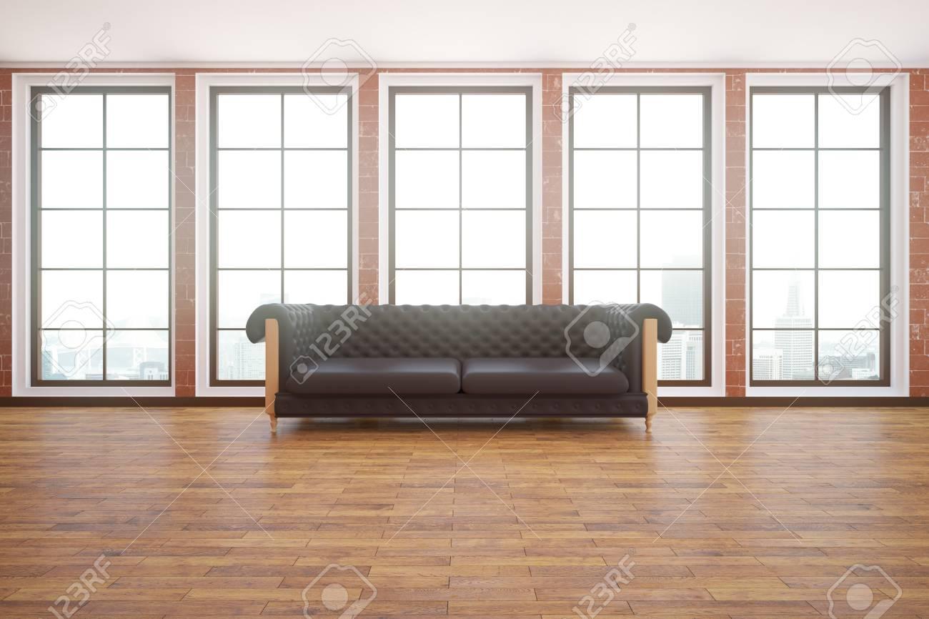 Interni moderni con divano in pelle marrone e vista sulla città. Rendering  3D