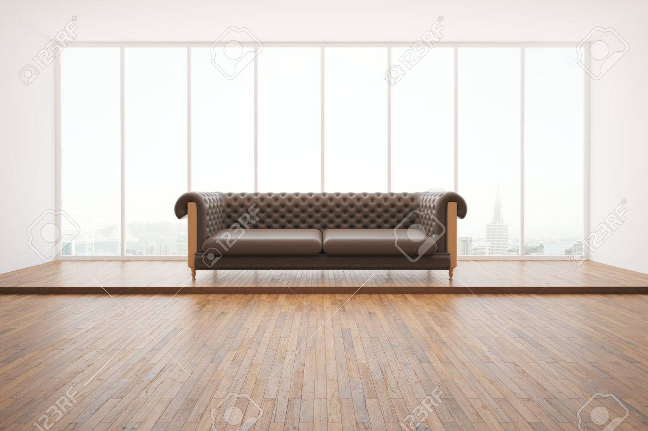 Front View Of Dark Leather Sofa In Bright Interior With Wooden ...