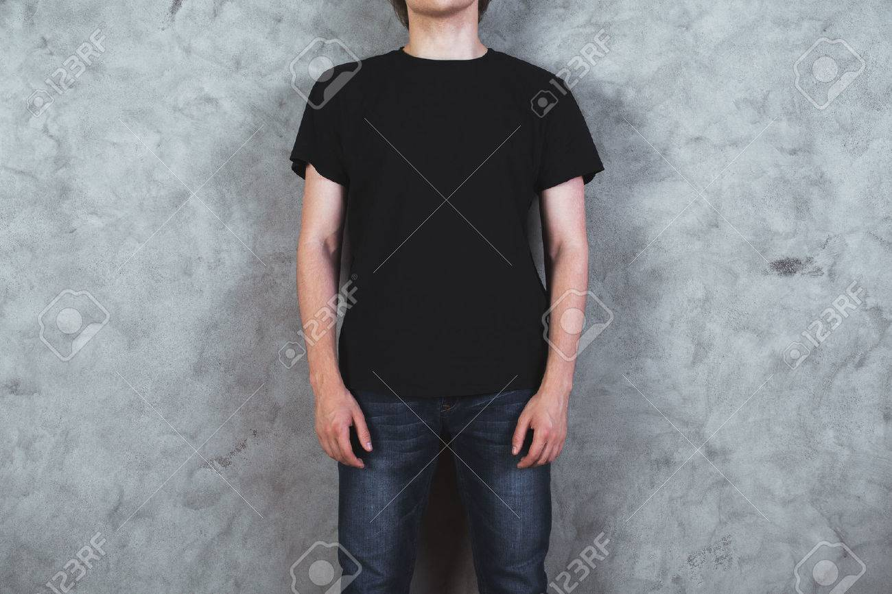 Front view of young boy in empty black shirt on concrete wall background. Mock up Standard-Bild - 65094666