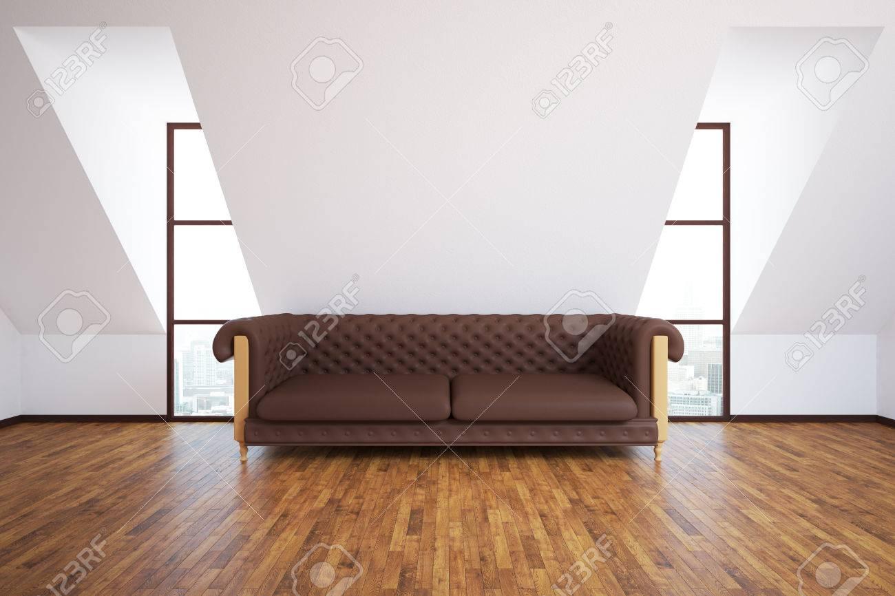 Vista frontale di interni moderni con divano in pelle marrone