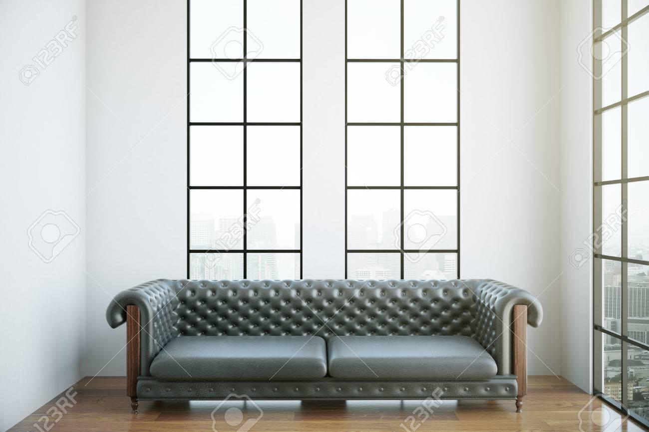 Interni moderni con divano di lusso in pelle marrone e vista sulla città.  Rendering 3D