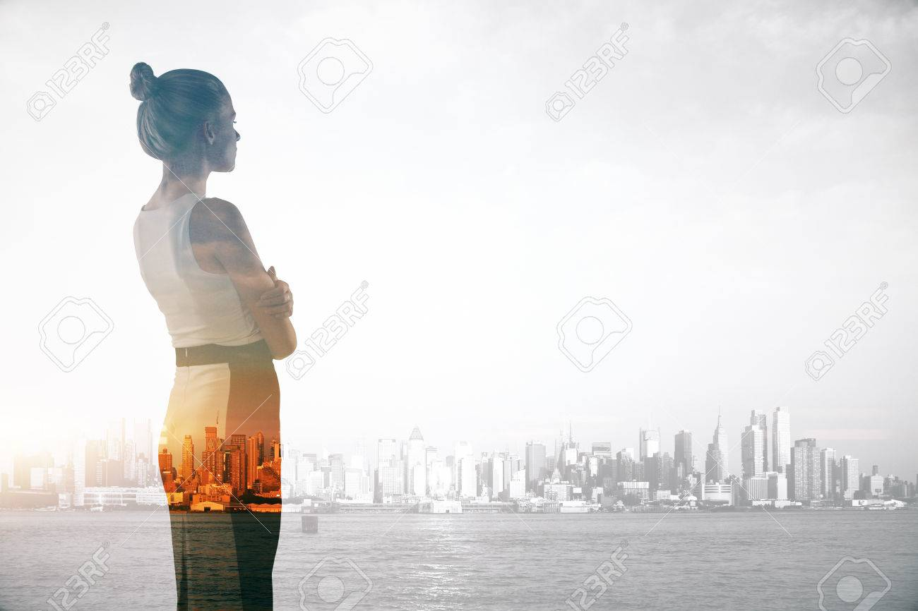 Attractive young businesswoman on abstract city background with copy space. Double exposure. Research concept - 68522816