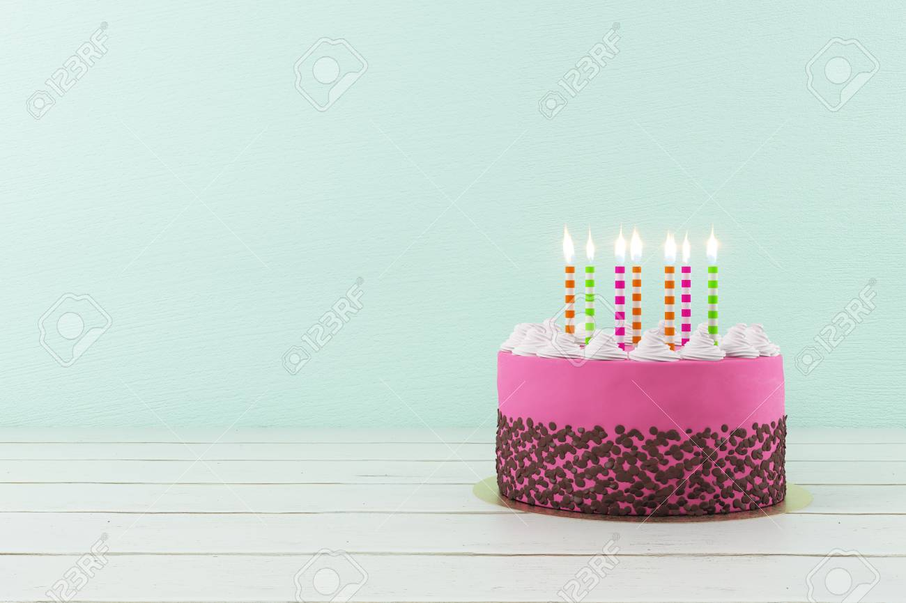 Pretty Birthday Cake With Lit Candles On Light Background Copy Space Anniversary Concept
