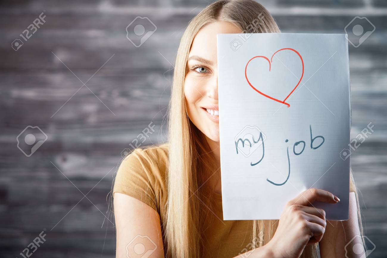Attractive young woman with love my job text on wooden background. Success and occupation concept - 91523962