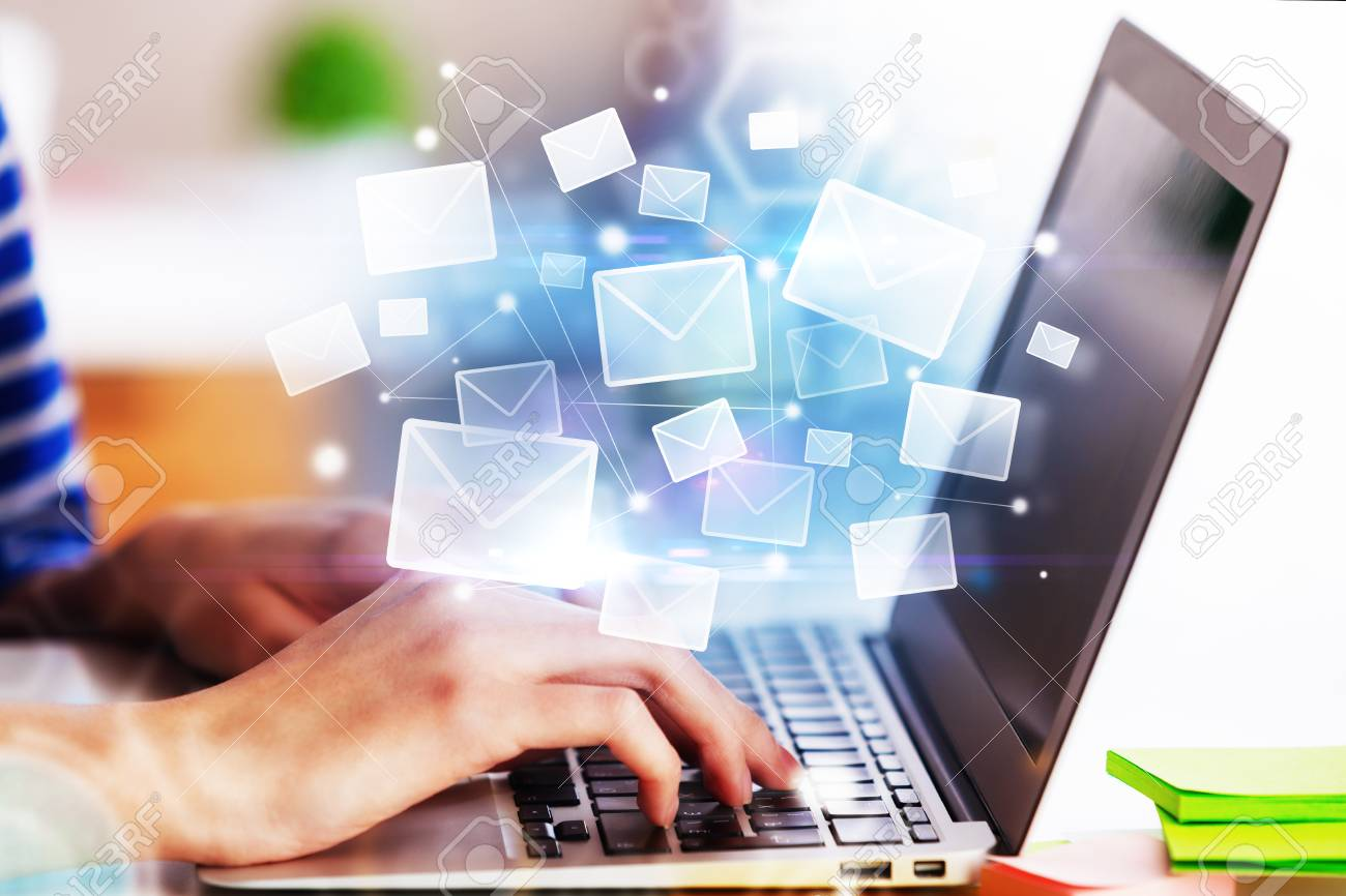 Hands using laptop with abstract email interface. E-mail networking concept. 3D Rendering - 91524013