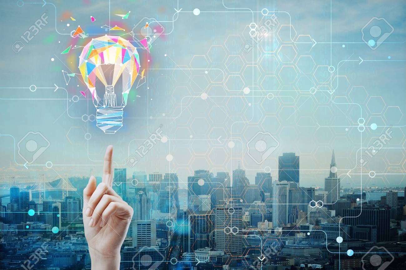 Hand pointing at abstract polygonal lamp on city background with circuit and copyspace. Power and idea concept. Double exposure - 91524922