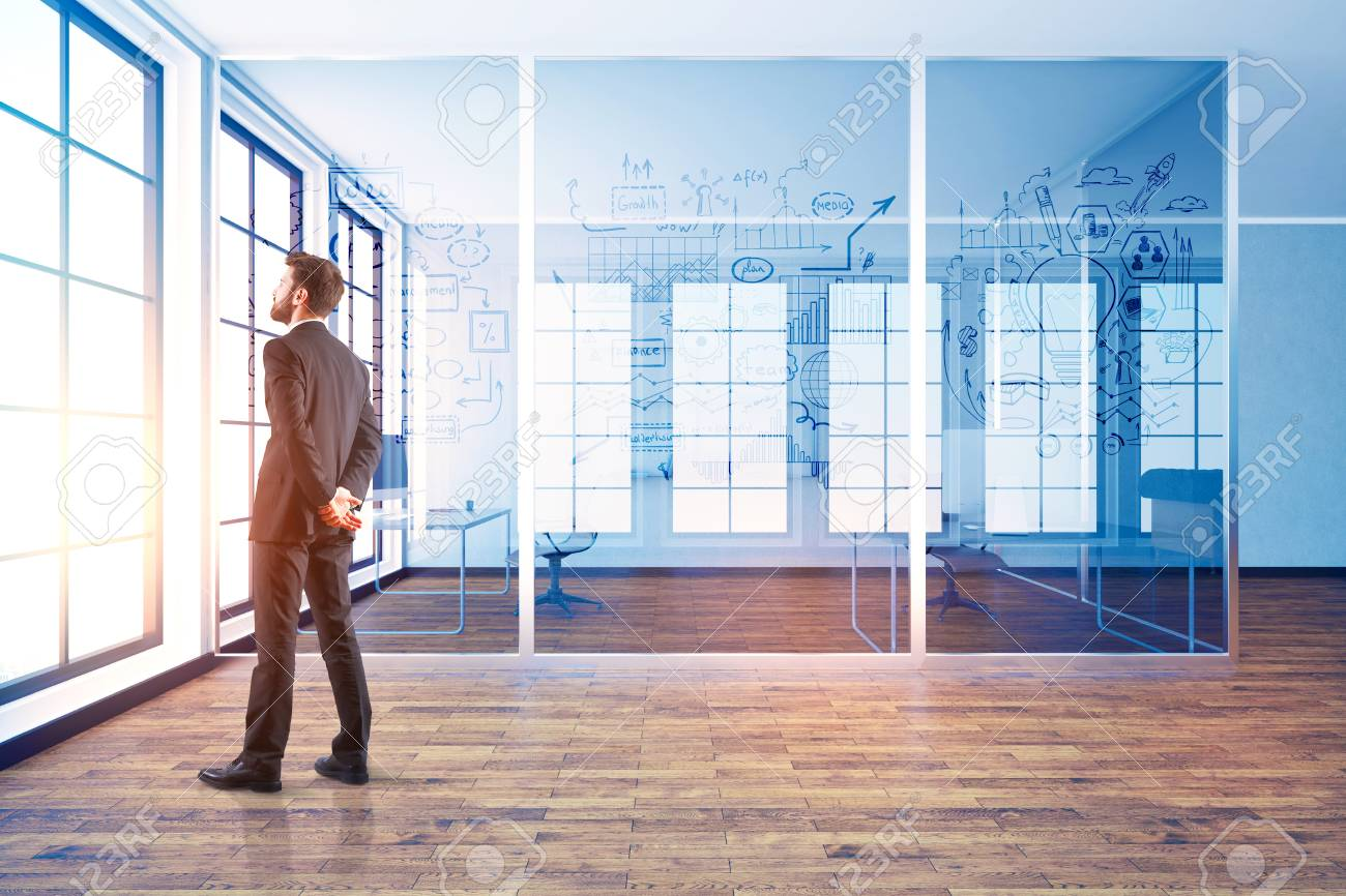 businessman in modern office interior with abstract business stock