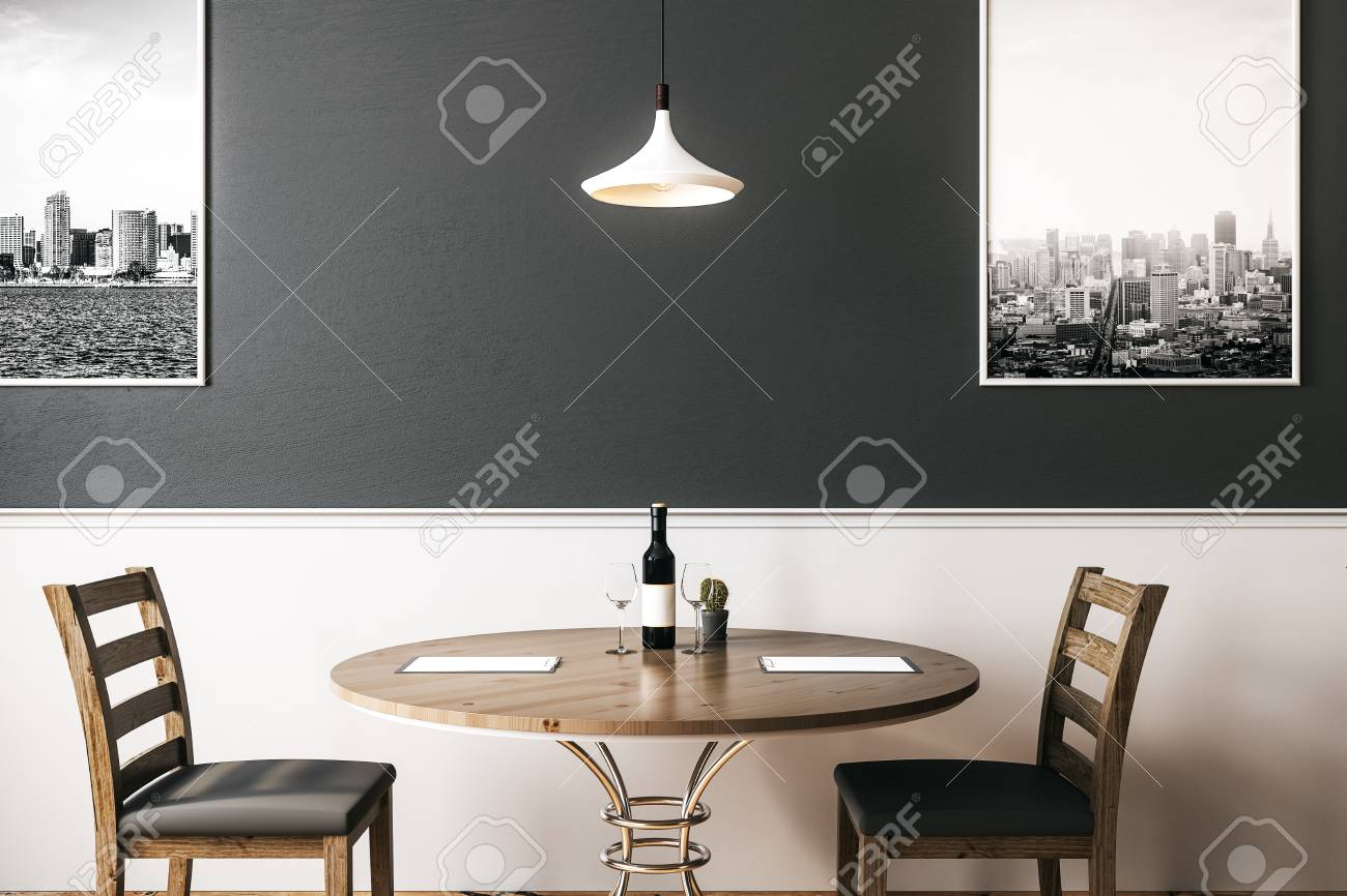 Modern Interieur Wit : Two wooden chairs with round table with wine bottle in modern