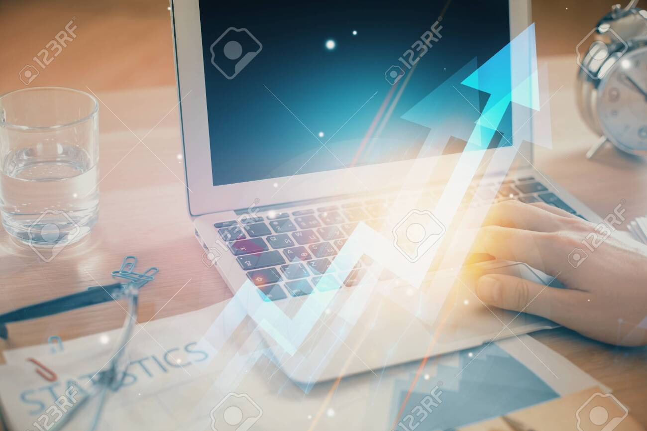 Growing arrows with businessman working on computer on background. Success concept. Double exposure. - 124971461