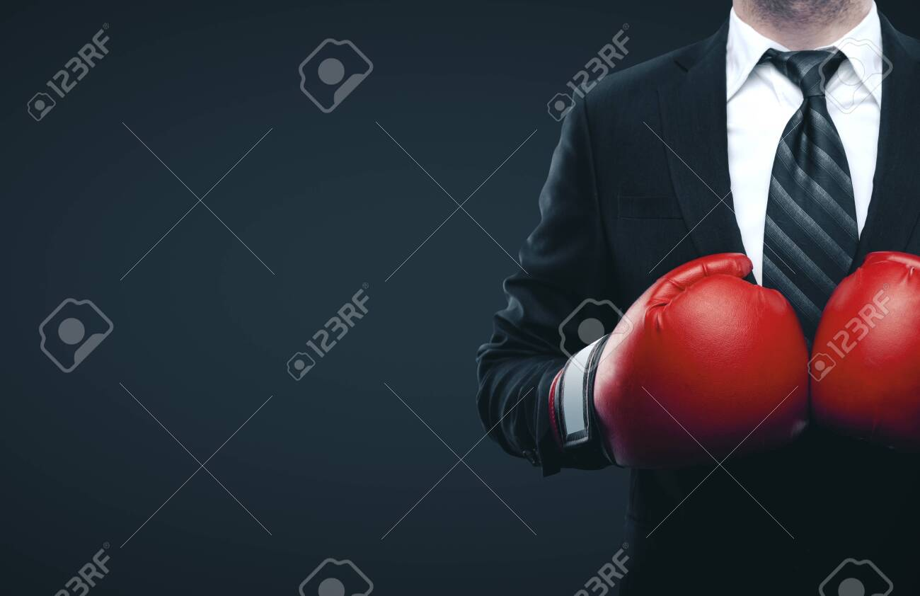 Businessman in red boxing gloves isolated on gray background. Business challenge concept - 131455731