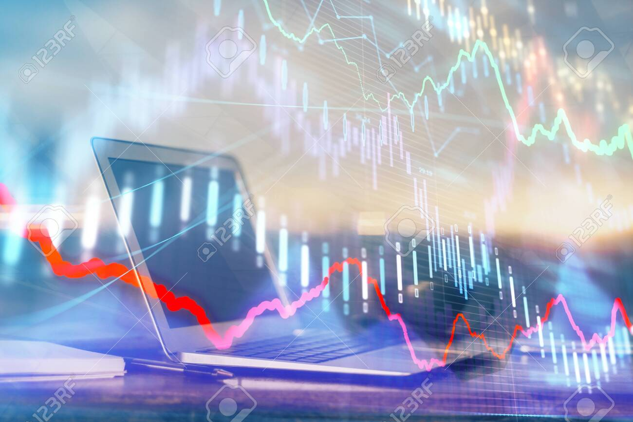 Forex market graph hologram and personal computer on background. Multi exposure. Concept of investment. - 132658413