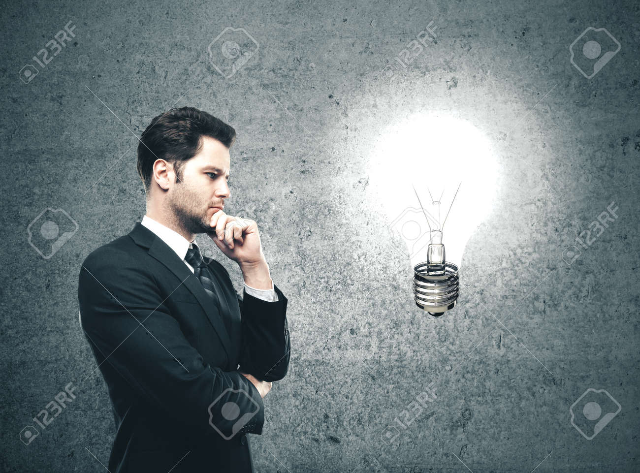 Businessman looking on glowing lamp Success and startup concept. - 140815444