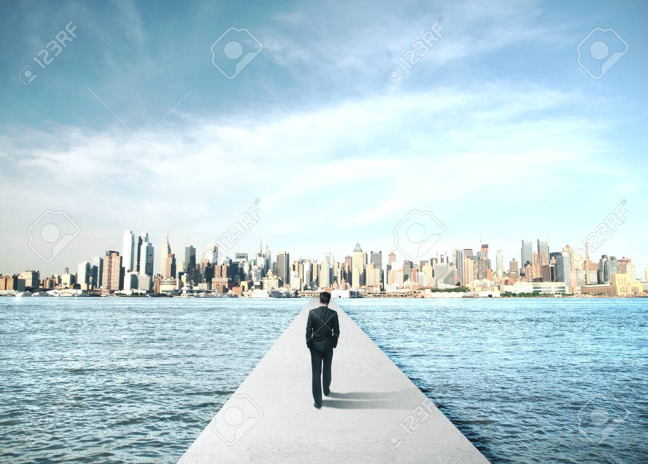 Businessman walking to modern city on concrete bridge. Business and challenge concept. - 141753223