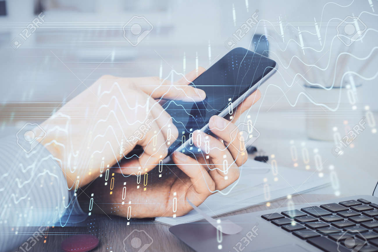 Double exposure of man's hands holding and using a digital device and forex graph drawing. Financial market concept. - 154144398