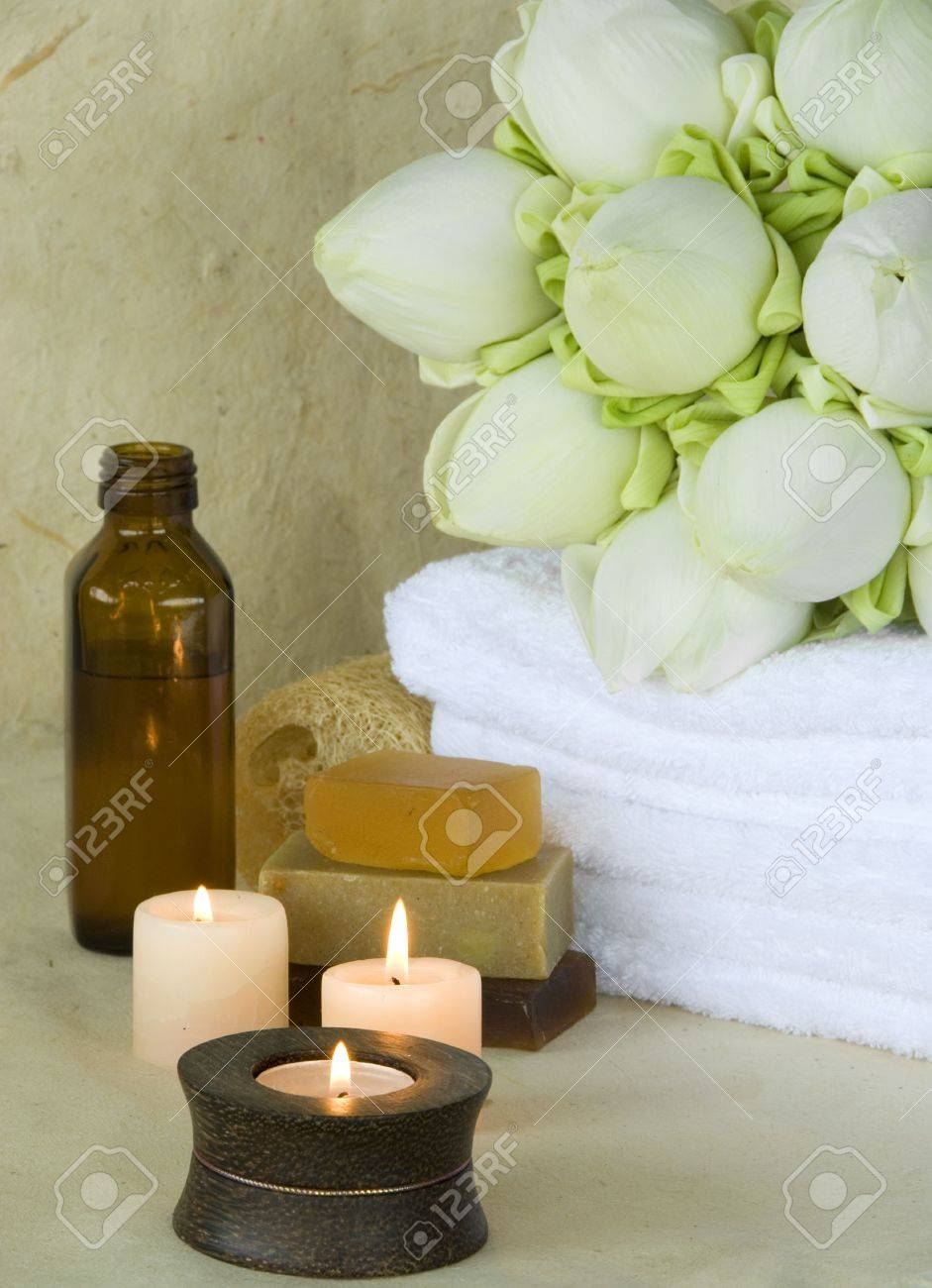 Spa products massage oil with candles and soap with lotus flowers spa products massage oil with candles and soap with lotus flowers with background of handmade paper dhlflorist Gallery