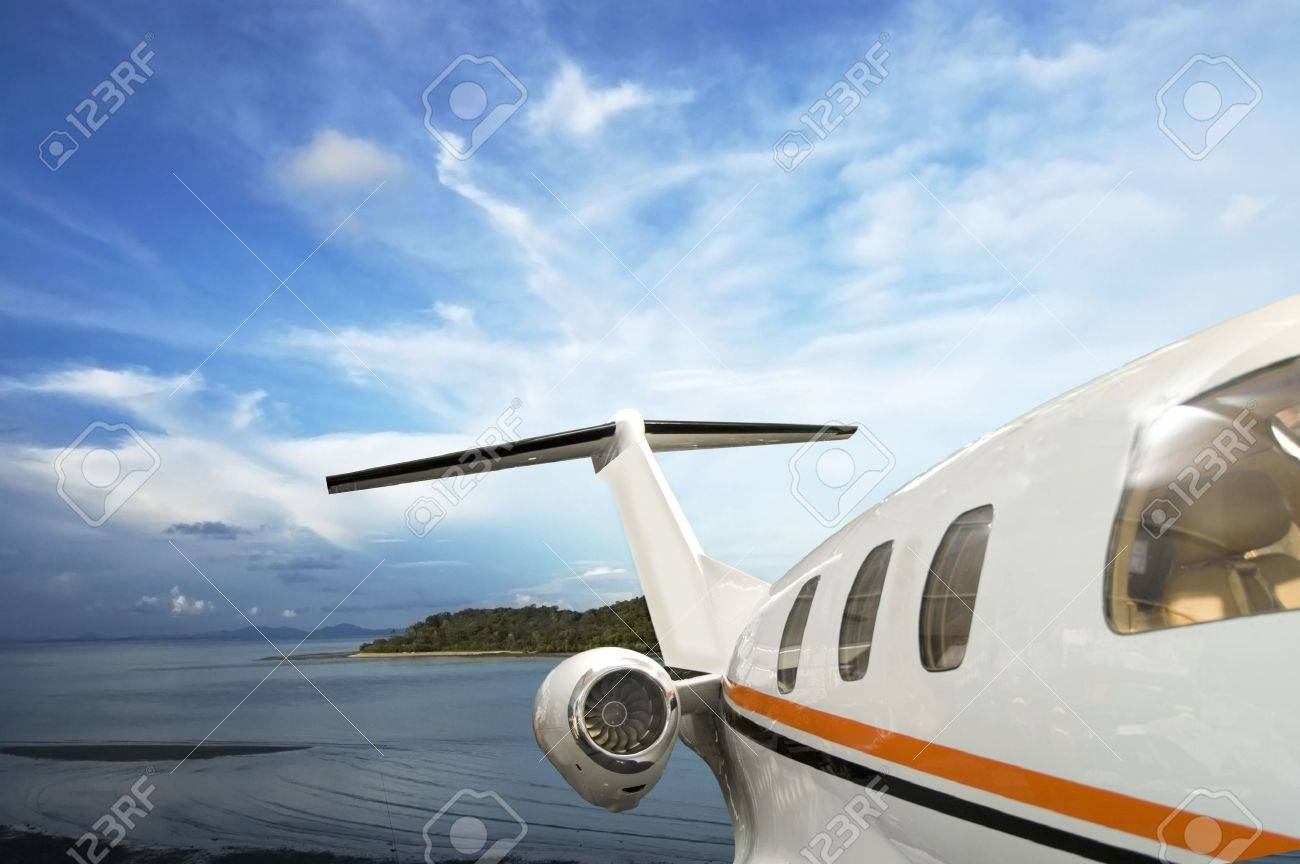 private jet flying over tropical Island Stock Photo - 2435513