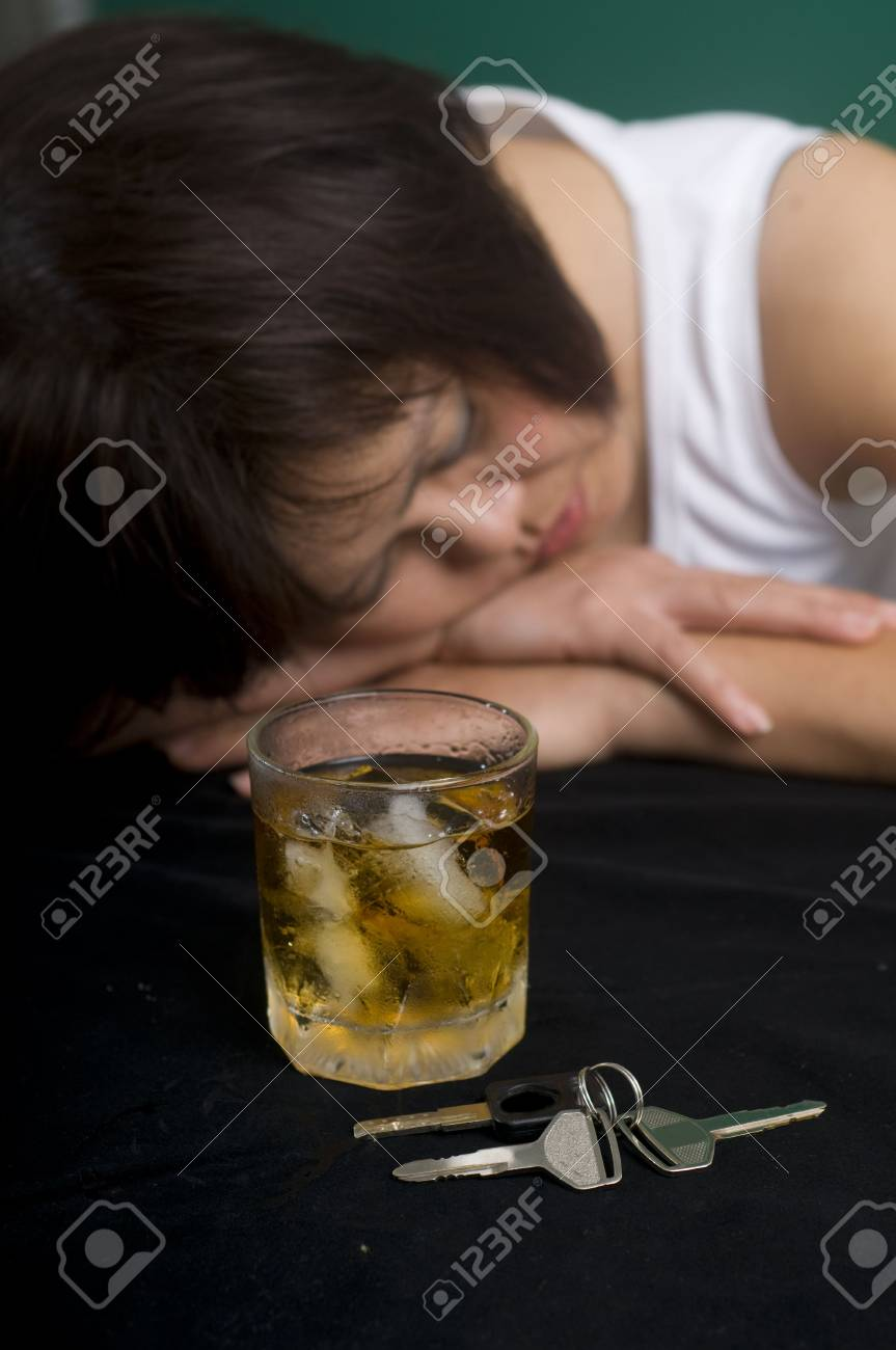 dark portrait of a woman with an alcoholic drink and car keys Stock Photo - 5635886