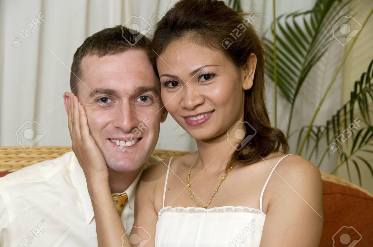 Asian woman and caucasian man embracing Stock Photo - 5635879