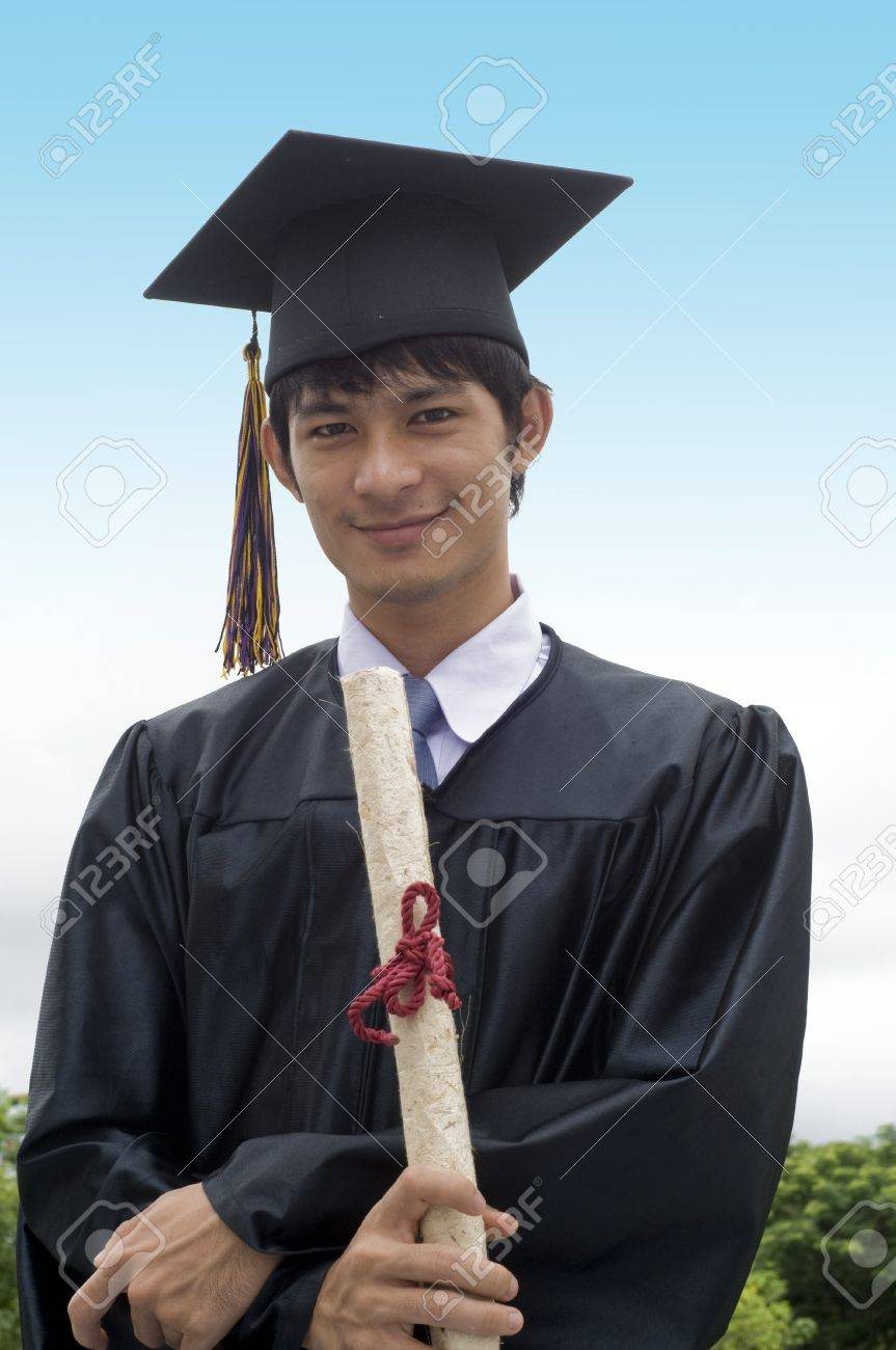 Young Man With Graduation Cap And Gown And Diploma Stock Photo ...