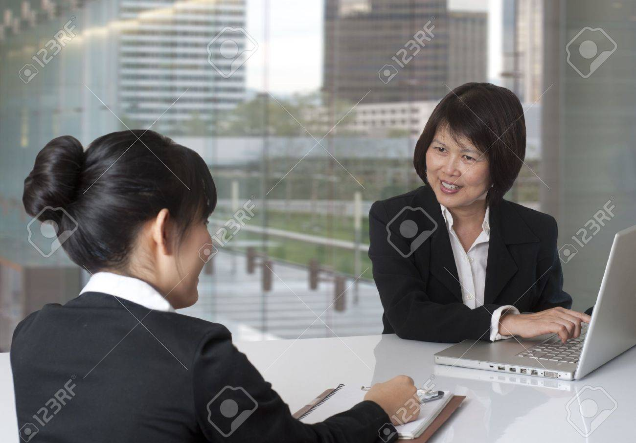 two women having a business meeting stock photo picture and stock photo two women having a business meeting