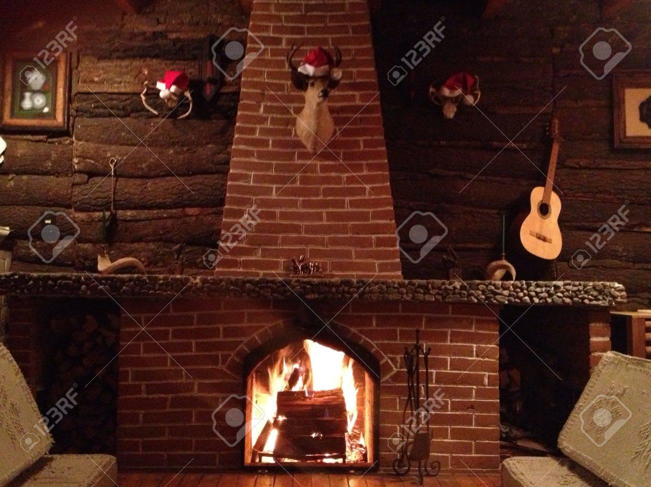 Light up christmas seasonal fireplace on a sunday night. Stock Photo - 20828197