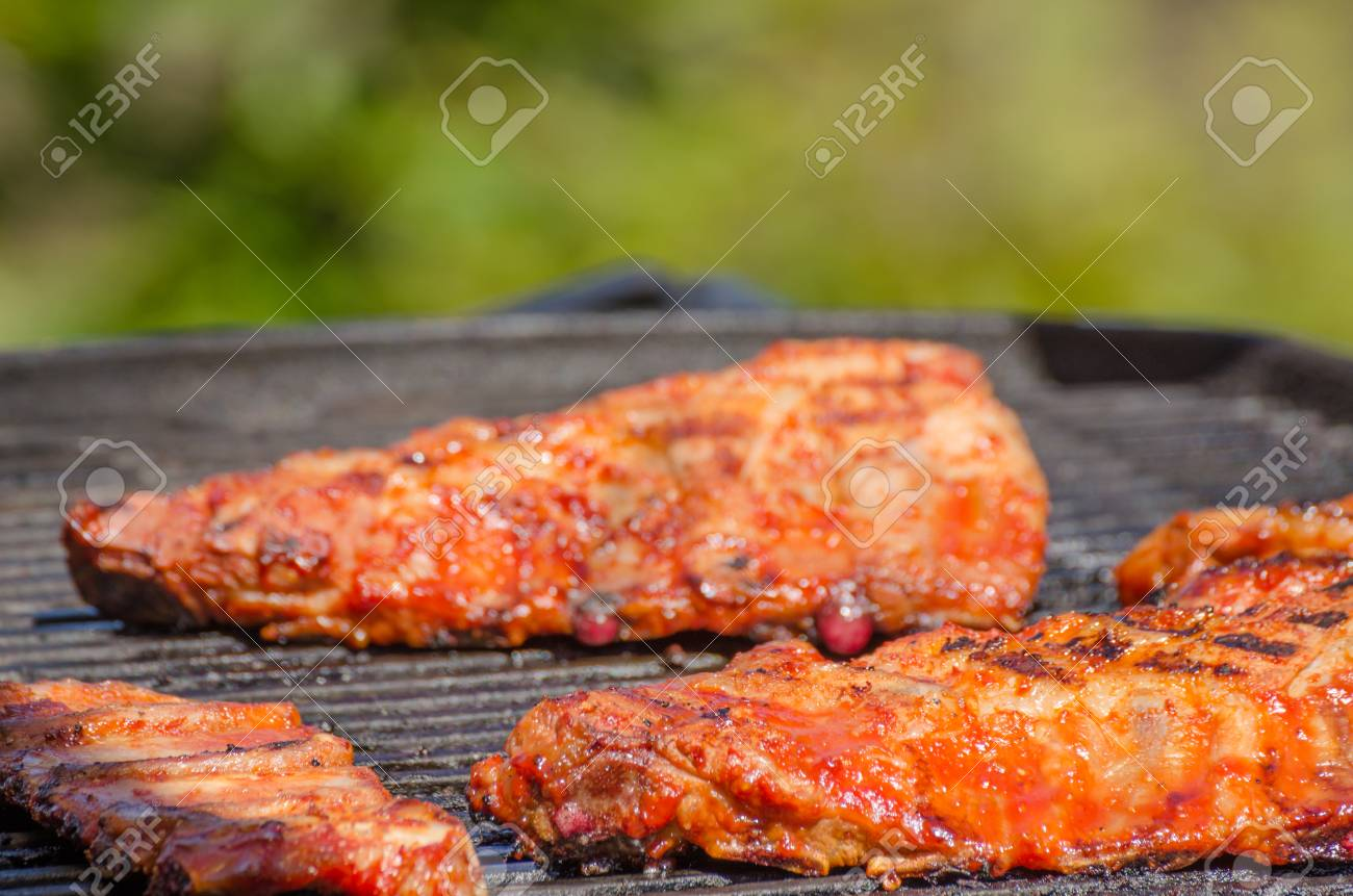 Spareribs På Gasgrill : Spareribs on grill with hot marinade stock photo picture and
