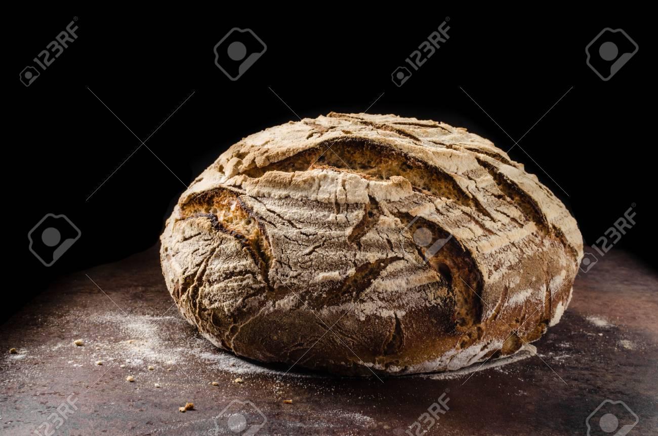 Homemade bread sourdough, rustic baked bread in wickerwork basket - 57348931