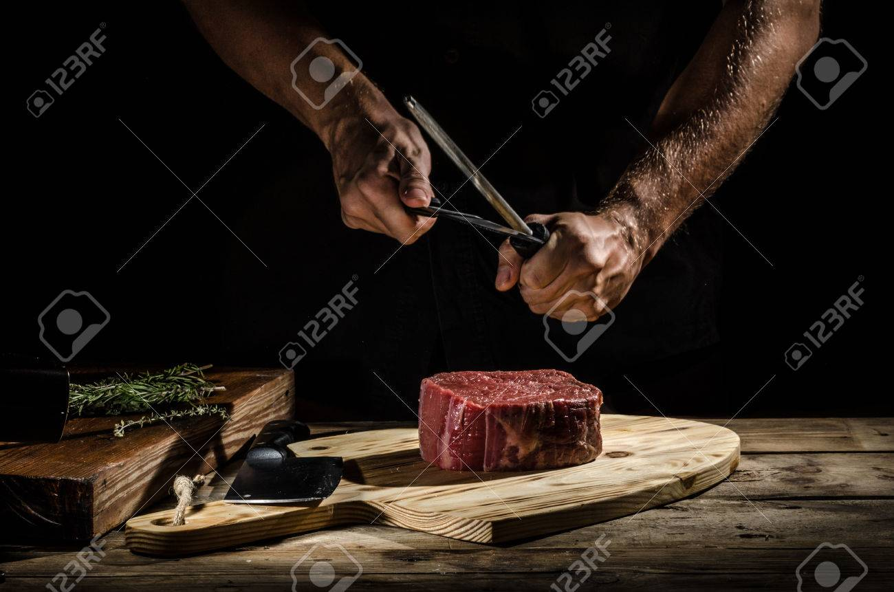 Butcher with a beef steak - 60102541