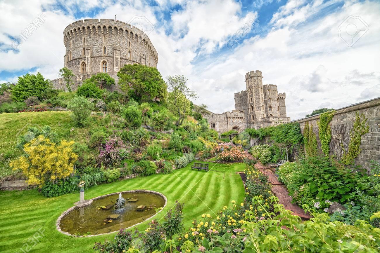 Stock Photo - WINDSOR, ENGLAND - JULY 10, 2016: Summer view for castle  gardens in Medieval Windsor Castle. Windsor Castle is a royal residence at  Windsor in ...