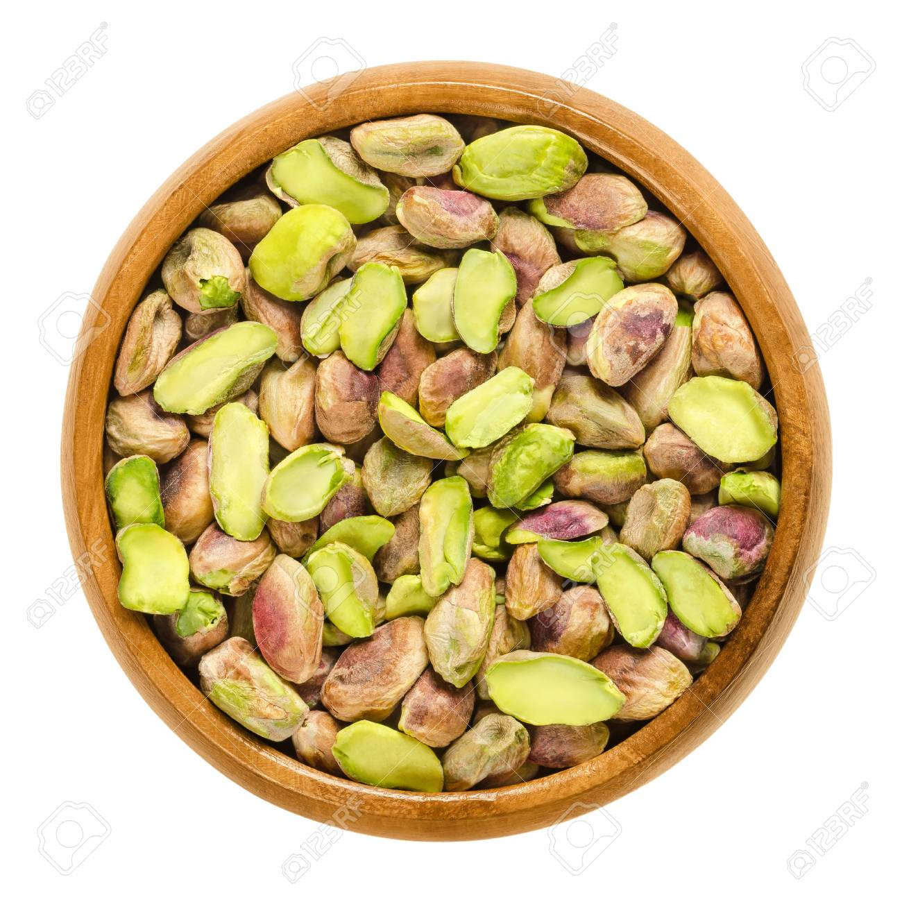 Shelled Pistachio Kernels In Wooden Bowl. Dried Seeds And Ripe ...
