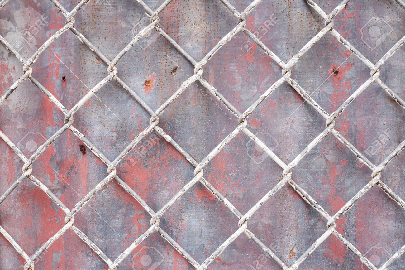 Steel Wire Mesh On Rusty Galvanized Background. Stock Photo, Picture ...