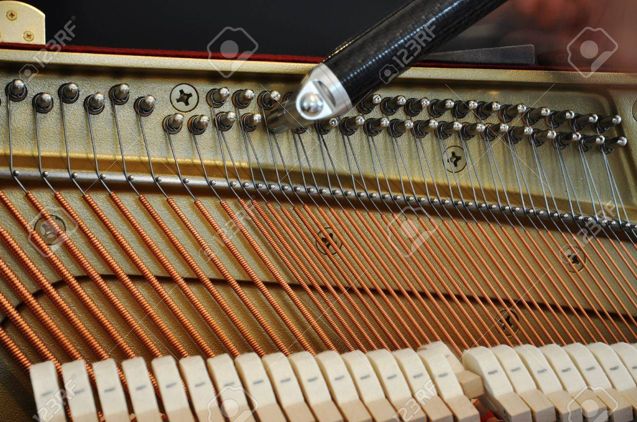 Adjusting the strings tension with a tool Stock Photo - 8932624