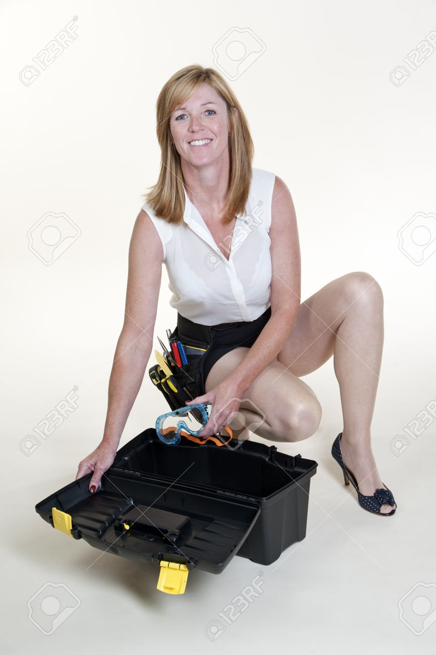 Woman Wearing Short Skirt And Long Legs With Toolbox Stock Photo ...
