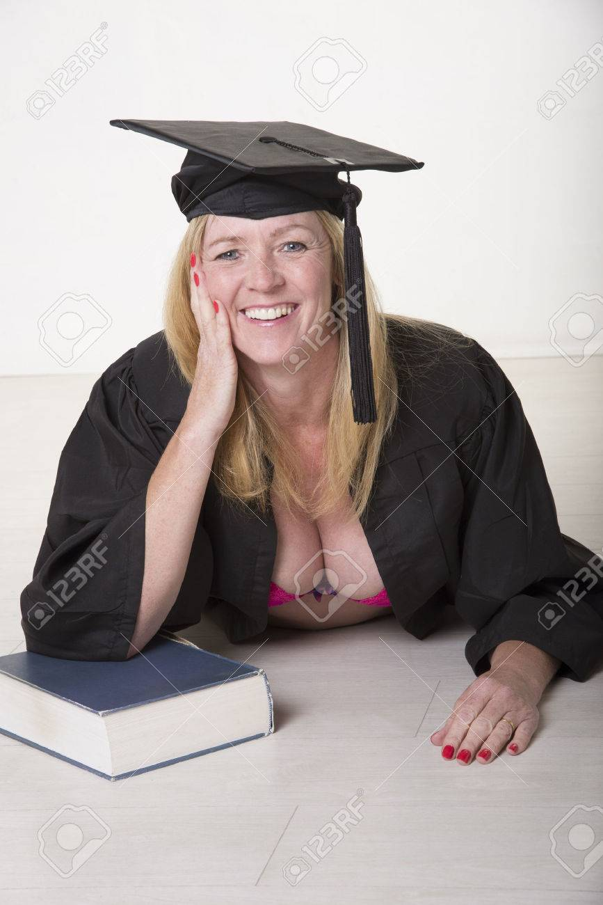Female Mature University Student Wearing Cap And Gown Stock Photo ...