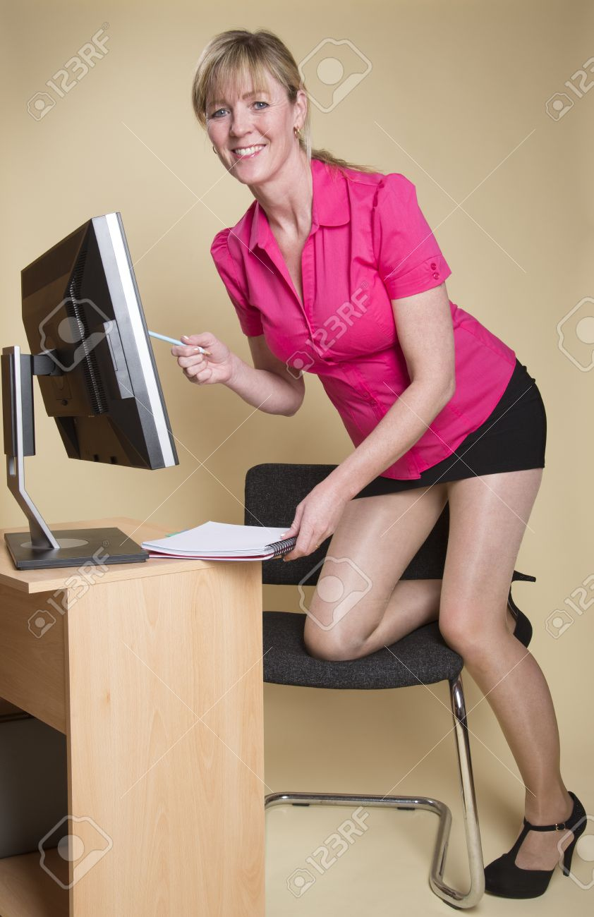 secretary in an office with computer screen stock photo, picture and